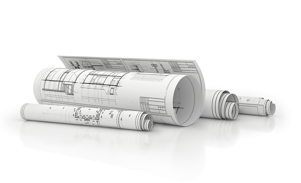 gedruckte und gerollte Pläne liegend